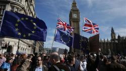 Britain tells dozens of EU citizens to leave