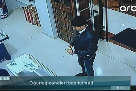 Gəncin oğurluq cəhdi anbaan kameraya düşdü - Video