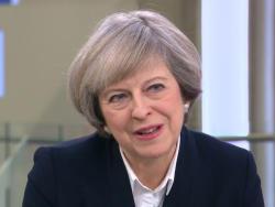 Theresa May at Brussels EU summit to urge short delay -