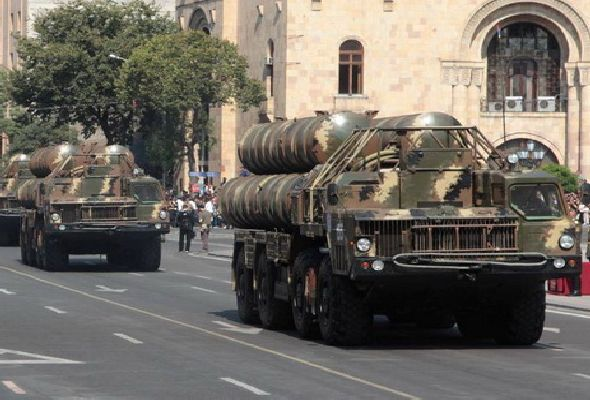 Who transported Serbian weapons to Yerevan and how?