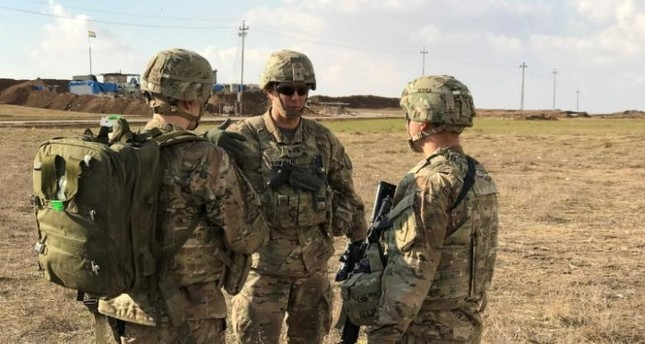 Armed Mexican troops question American soldiers