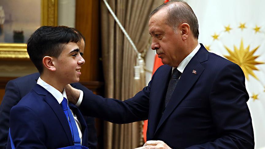 Erdogan receives Palestinian teen Fawzi al-Juneidi