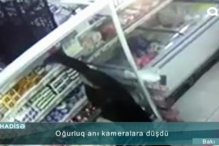 Bakıda mağazadan oğurluq anı kameraya düşdü - Video