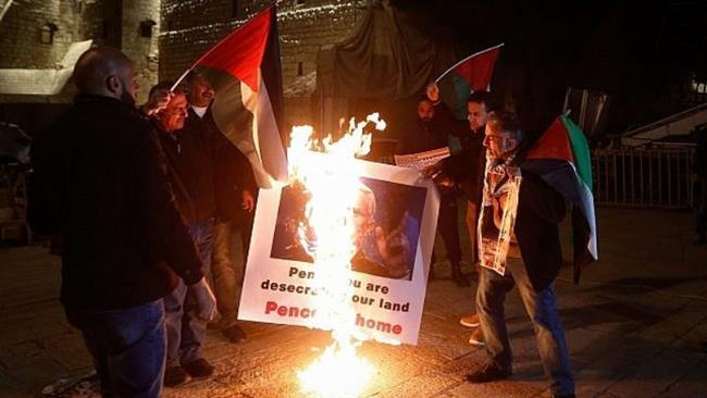 Palestinians burn Pence's photos, say visit 'desecrating'