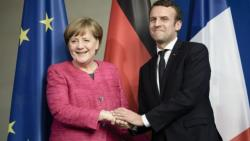 Merkel and Macron share a tender moment