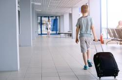 Australian boy, 12, flies to Bali with family's card