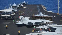 US protests as China lands bombers on island
