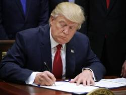 Trump's 2020 campaign suing ex-aide over explosive book
