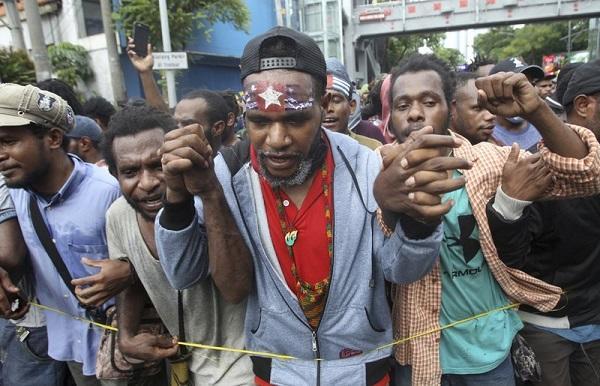 Local parliament torched in Papua unrest