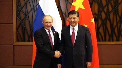 Putin says hopes to meet with China's Xi at BRICS, APEC summits