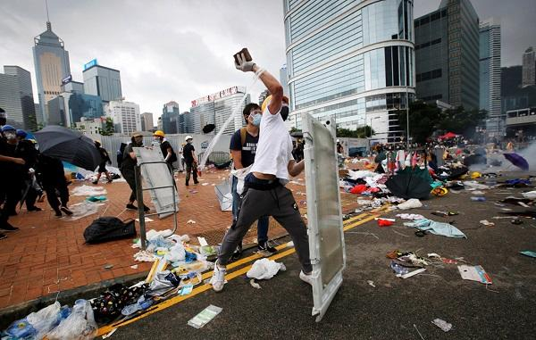 Hong Kong police fire tear gas after protesters throw bombs