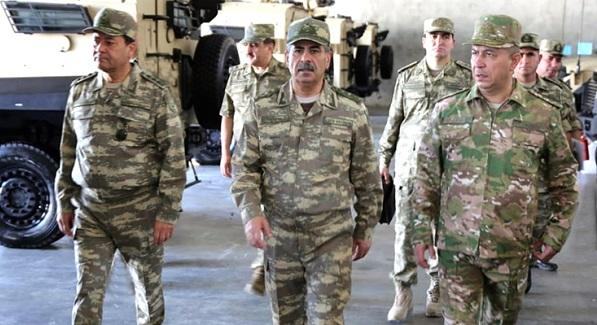 The military units are being inspected by Minister -