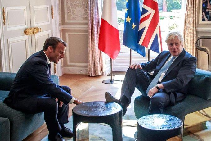 Johnson laid his foot on the table at meeting with Macron