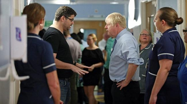 Johnson confronts by furious dad in hospital -