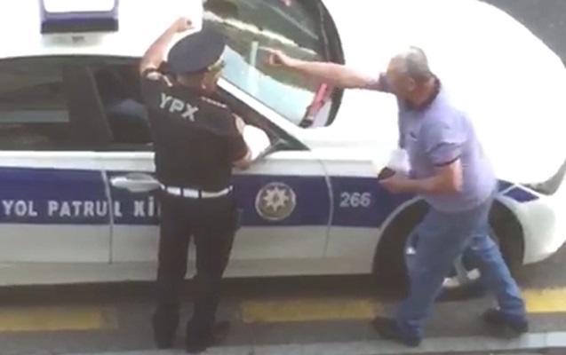 Polisi təhqir edən sürücü üzr istədi - Video