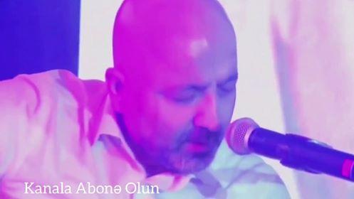 Mübariz Mənsimov gitarada çalıb oxudu - Video