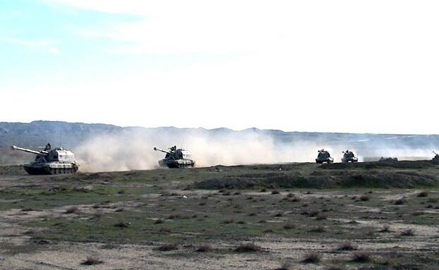 Artillery units move forward on designated routes -
