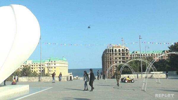 Sumqayıtda şok: helikopterlə sakinlərə dəvətnamə atıldı - Video