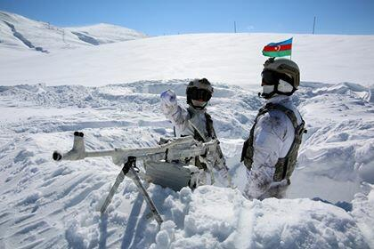 Azerbaijani soldier on snowy mountains -