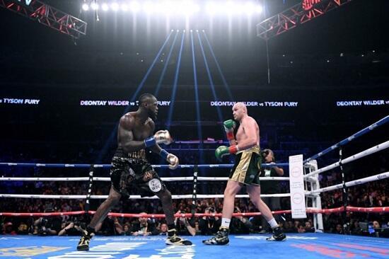 Tyson Fury beats Deontay Wilder in world title fight -
