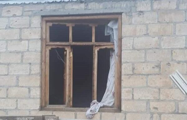 An artillery shell fired by Armenians hit this house -