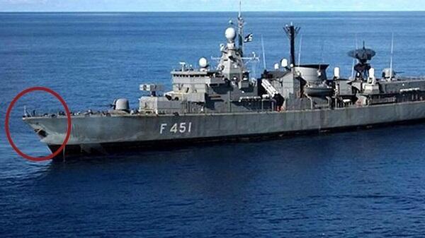 Türkiyə freqatı yunan gəmisini bu hala saldı - Foto