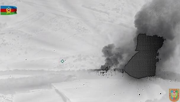 Düşmənin raket-artilleriya silahları anbarı məhv edildi - Video