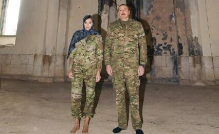 Ilham Aliyev and his wife in the Aghdam mosque -
