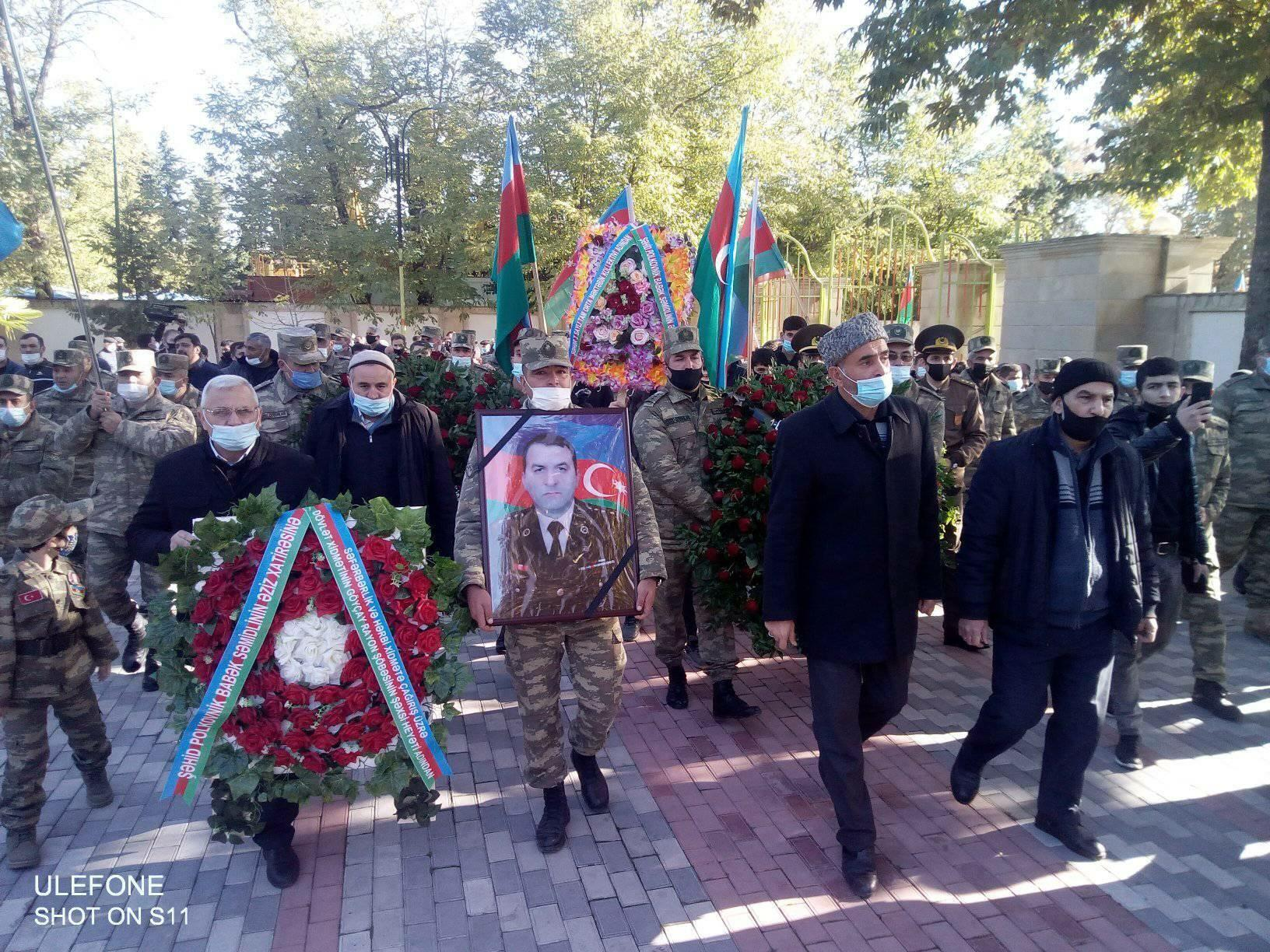 The martyred colonel was buried -