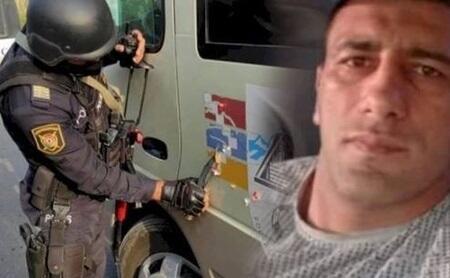 """Qondarma rejimin """"bayrağ""""ını silən polis kimdir? - Video"""